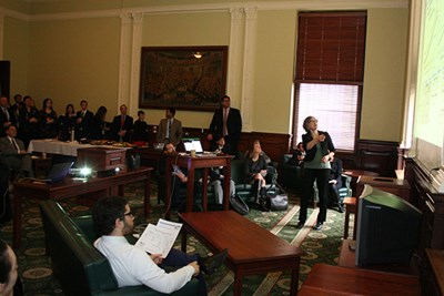 Juliette Rooney-Varga presents at the State House