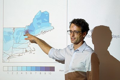 Chris Skinner points to a map of New England showing days snowstorms
