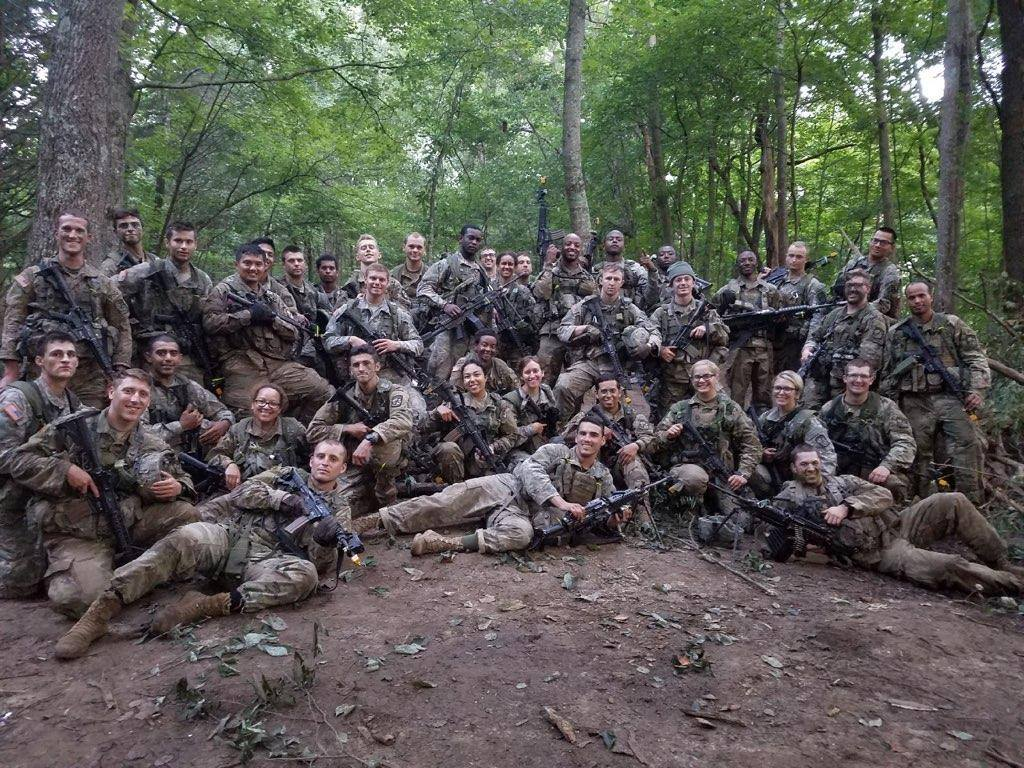 Cadets posing for a platoon photo in the woods after training