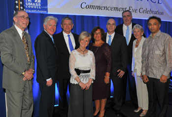 Honorees gather at the Commencement Eve celebration, which raised a record-breaking $725,000 for scholarships, from left: Bernie Shapiro '56; Chancellor Marty Meehan; Bill Mucica, brother of Gary Mucica, and Sally Mucica, wife of Gary Mucica;  Mark '81 and Elisia Saab; Edward Davis; Nancy L. Donahue; and Harish Hande '98, '00.