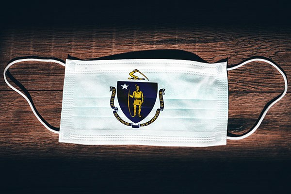White face mask with Massachusetts state seal on it