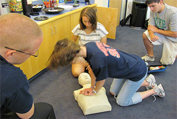 UMass Lowell's emergency medical services train students in CPR.