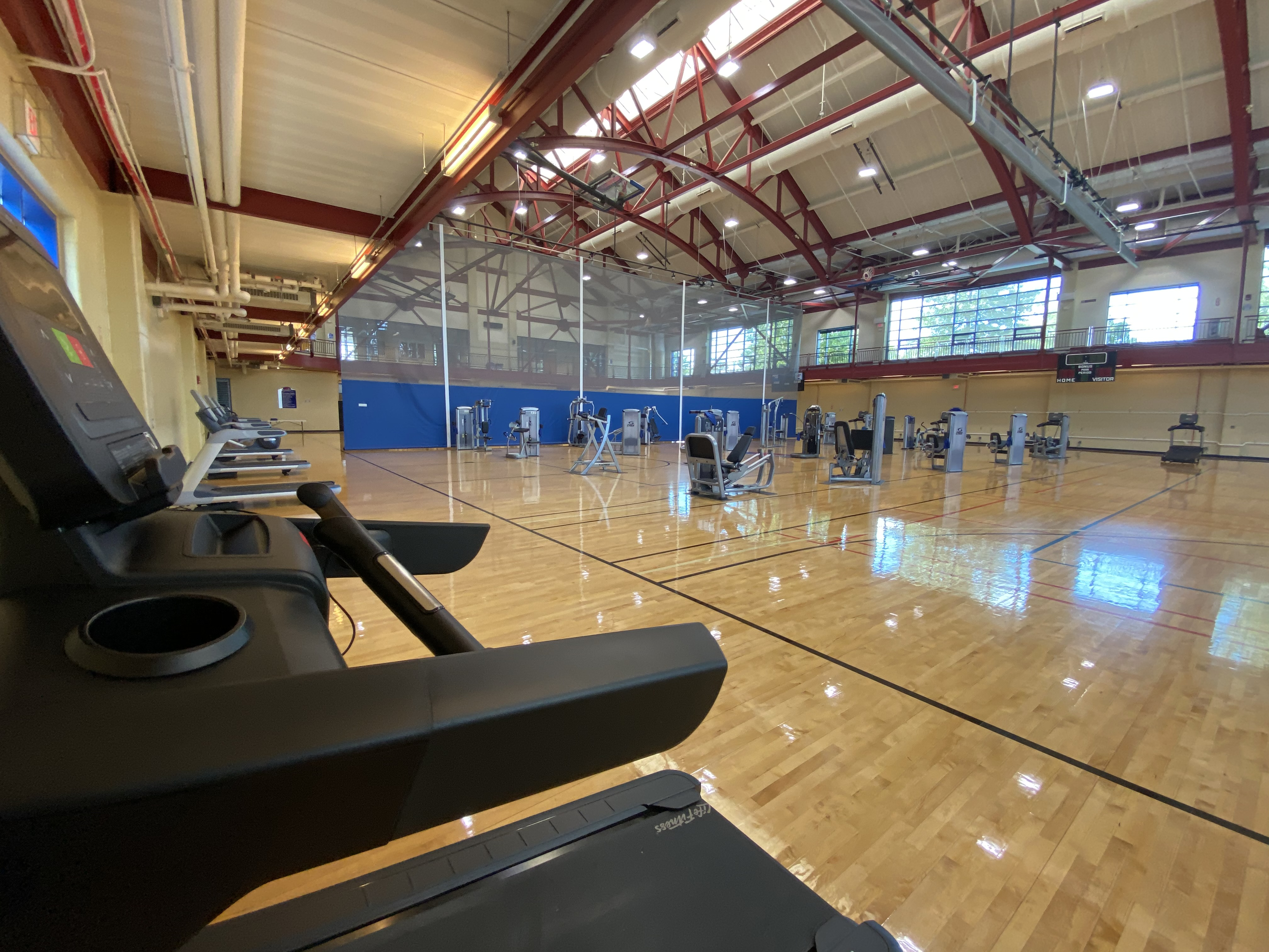Spaced exercise equipment on basketball courts