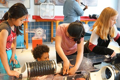Students from Hillside Elementary School in Needham, MA, create a mill and canal system in the Power to Production room at the Tsongas Industrial History Center in Lowell