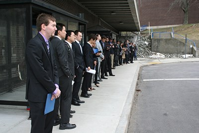 Students wait for a bus to the career fair on North Campus