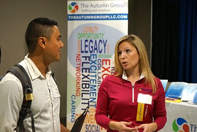 The Autumn Group's Melissa Simone talks to a Career Fair visitor