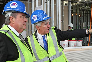 UMass President Robert Caret, left, with UMass Lowell Chancellor Marty Meehan during a tour of the Emerging Technologies and Innovation Center under construction.