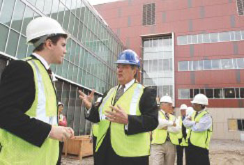 UMass President Robert Caret, center, talks with UMass Lowell student trustee Jim Tarr of Methuen, after touring the new emerging-technologies building under construction.
