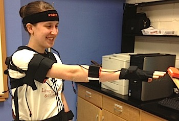 Exercise Physiology major Caroline Stark dons a motion detector suit with sensors that measures body motion.
