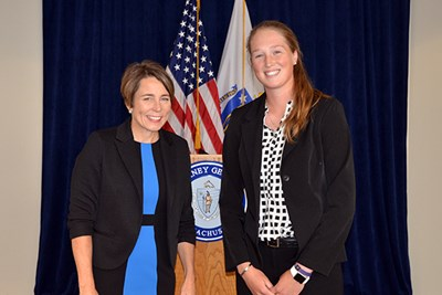 Massachusetts Attorney General Maura Healey poses for a photo with Courtney Cashman