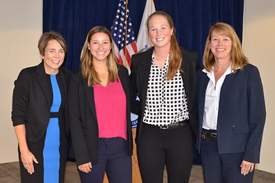 Maura Healey, intern Mary Manganaro, Courtney Cashman and Detective Lieutenant Mary McCauley pose for a photo