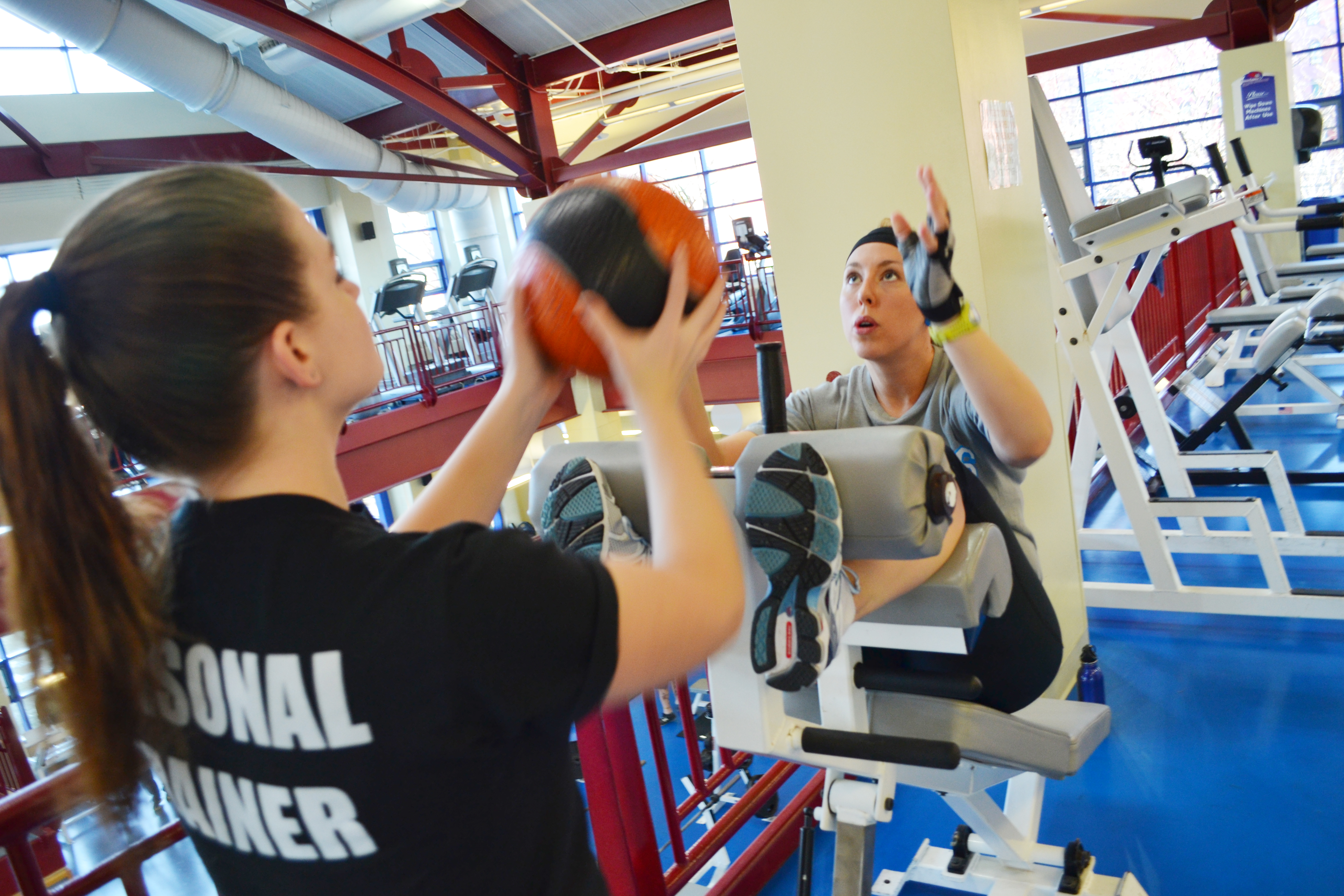 Personal Trainer Working with Student