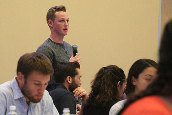 A student asks the panel a question at the Chancellor's Forum, presented by the Student Government Association.