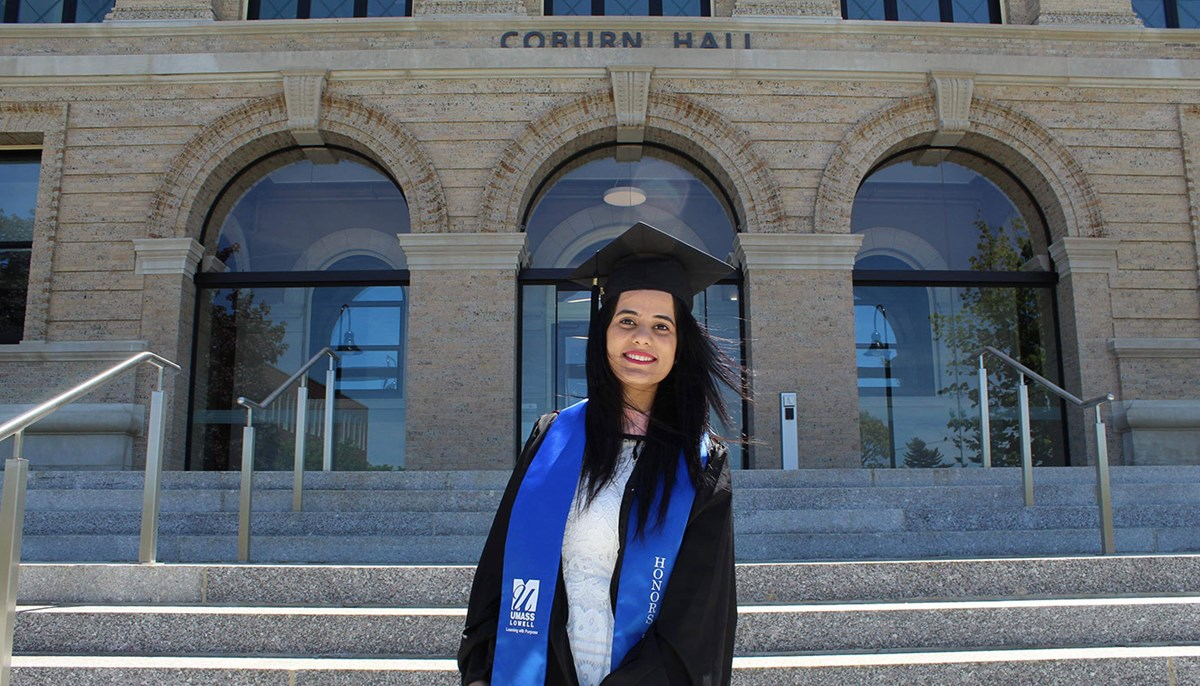 Chandni Shahdev in front of Coburn Hall in UMass Lowell south campus