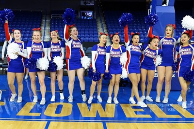 The UML cheerleaders root on the women's basketball team at the Tsongas Center