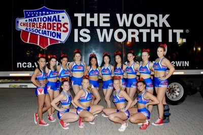 The cheerleading team poses for a picture at the NCA competition