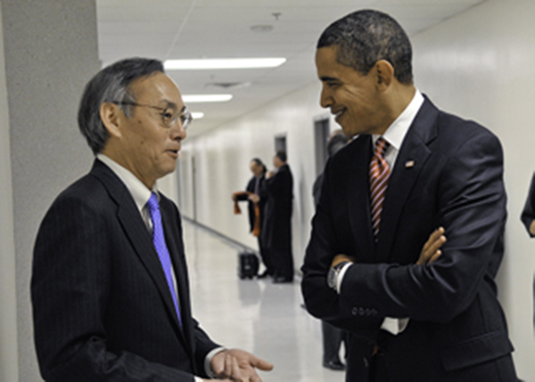 Steven Chu, left, is shown during his time as energy secretary speaking with President Obama in 2009.