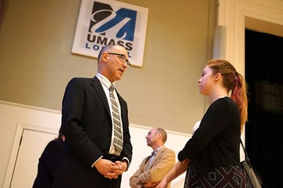 Carl Spector speaks with student Emma Hargraves after the teach-in