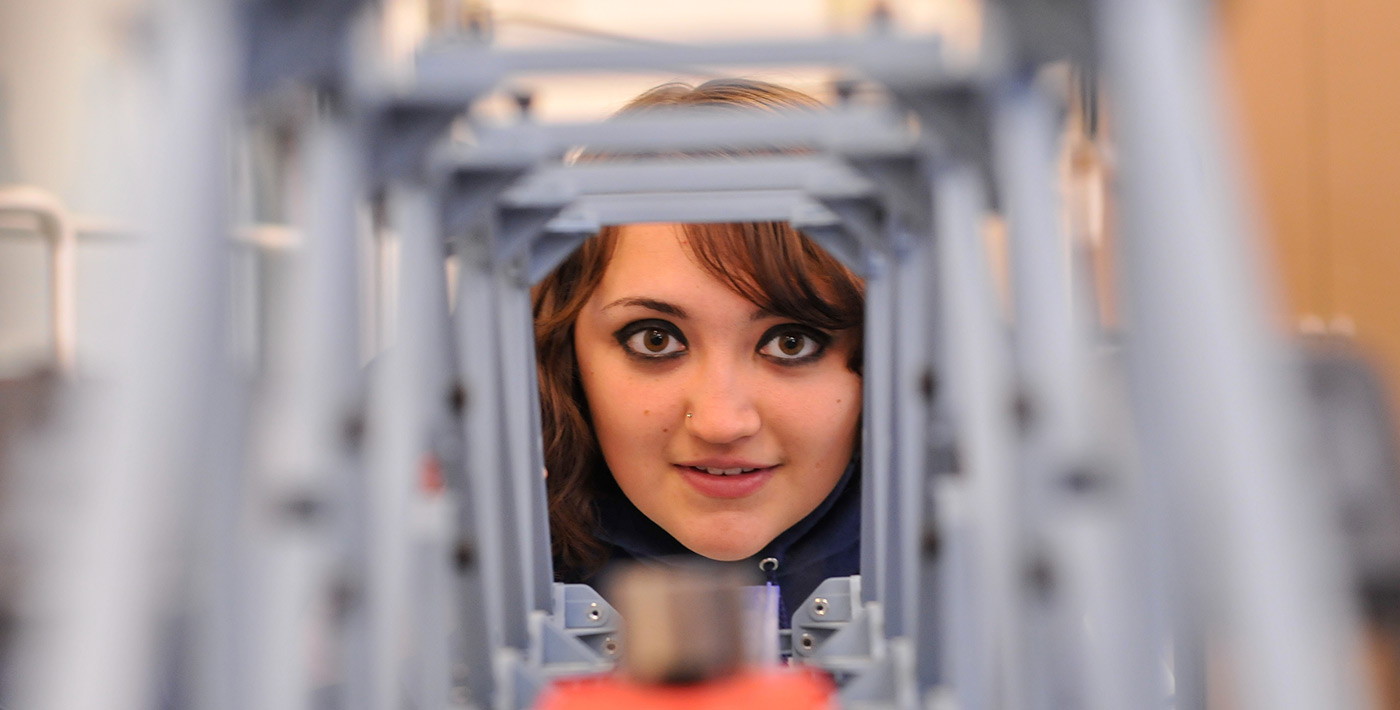 Civil Engineering Female Student Looking through tunnel like structure