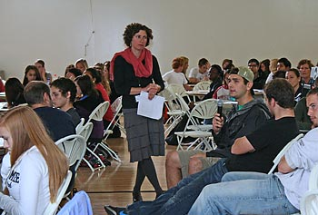 Biology Assoc. Prof. Juliette Rooney-Varga, standing, addresses the students during last year's Climate Change Teach-In.