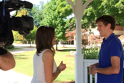 Asst. Prof. John Cluvrius chats with WCVB reporter Julie Loncich the day after the 2018 Massachusetts primaries