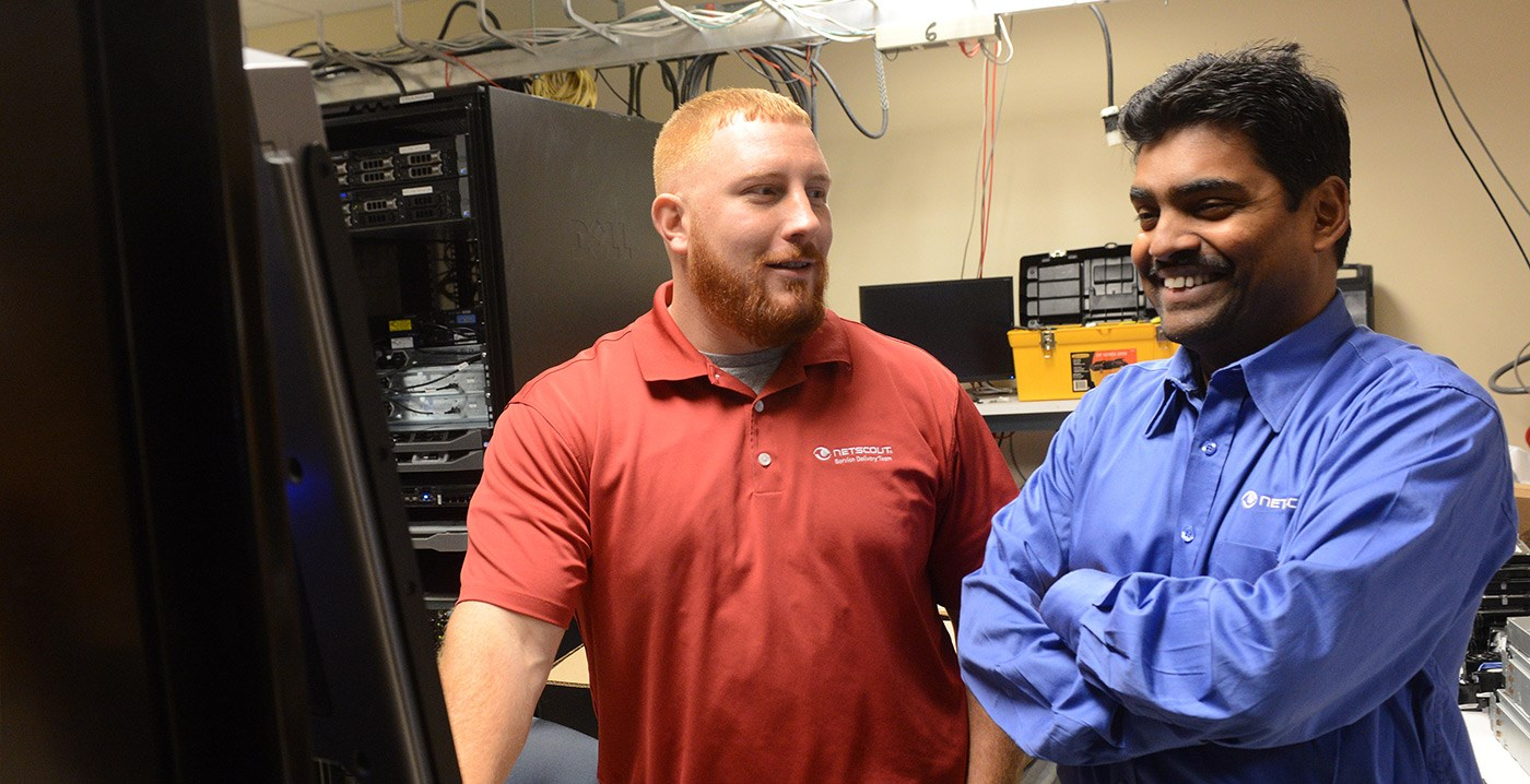 A UMass Lowell student veteran poses with a co-worker from his co-op at Netscout.