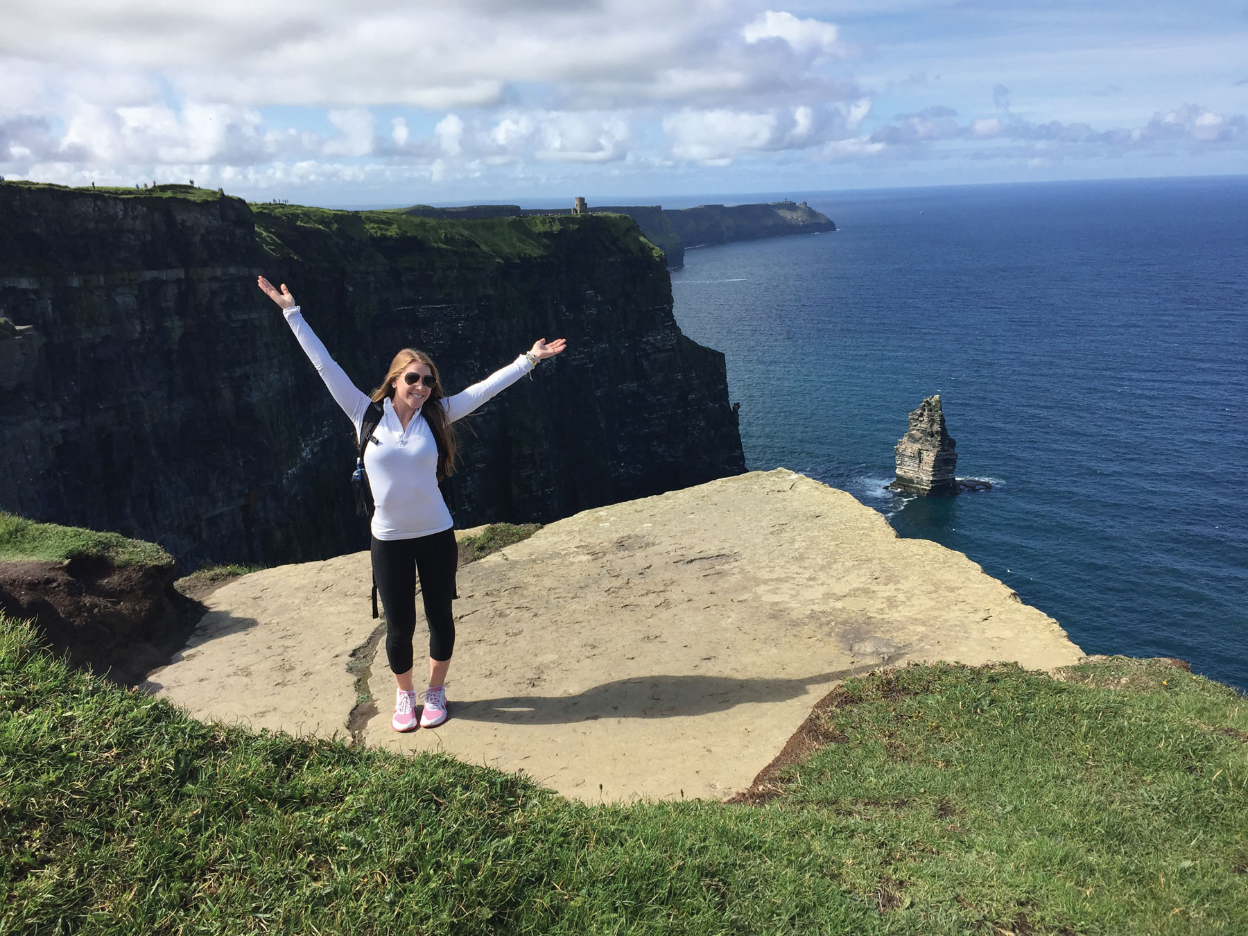 Colleen Franks standing on cliff in Europe