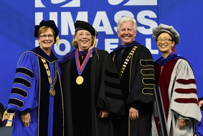 Chancellor Jacqueline Moloney, U.S. Rep. Niki Tsongas, UMass President Marty Meehan and Vice Chancellor for Research and Innovation Julie Chen at UMass Lowell Commencement.