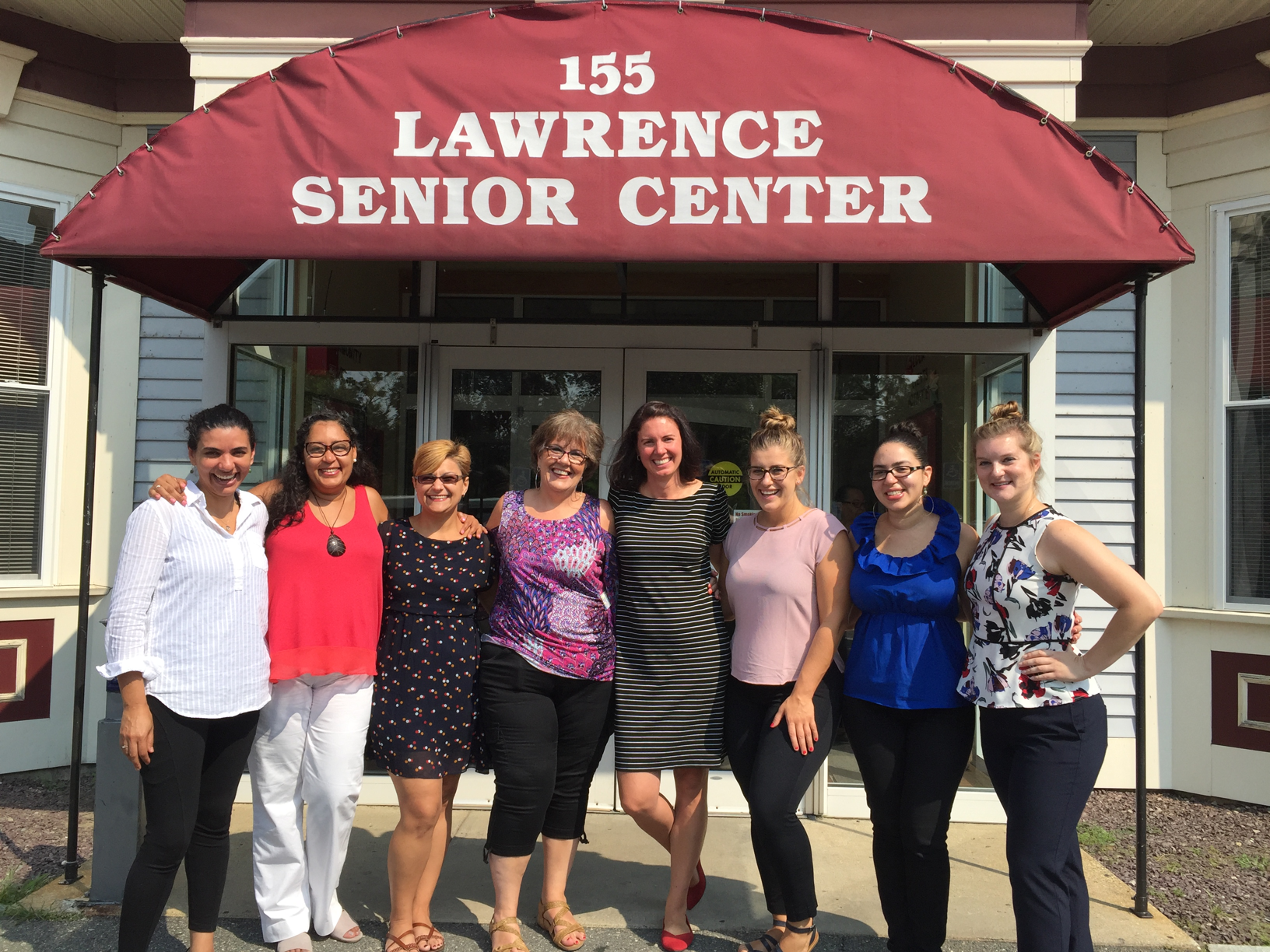 Sabrina Noel, Kelsey Mangano, and Michelly Santos in front of the Lawrence Senior Center