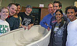 The 2011 Green Monster concrete canoe team includes, from left, students Susie Barnes, Jeremy Cahill, Ruth Tejada and Brian Allard, team adviser Gary Howe, and students David Nader, Meera Alanoly and Alvaro Sosa.