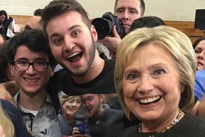 David Todisco takes a selfie with Hillary Clinton, wearing a t-shirt he made from a previous selfie with the candidate