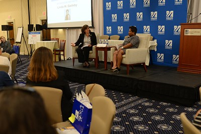 Linda M. Gadsby in conversation with Asst. Prof. Liz Altman at the UML Women's Leadership Conference, 2018