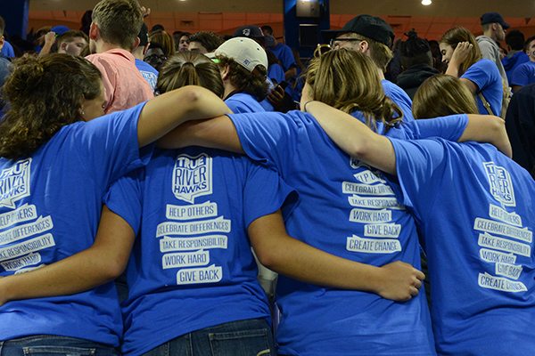 Freshman and new transfer students bonded at Convocation 2017, and showed off their new T-shirts, which describe what it means to be a River Hawk.