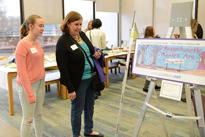 Students, their parents and teachers view the Cool Science winning and honorable mention posters.