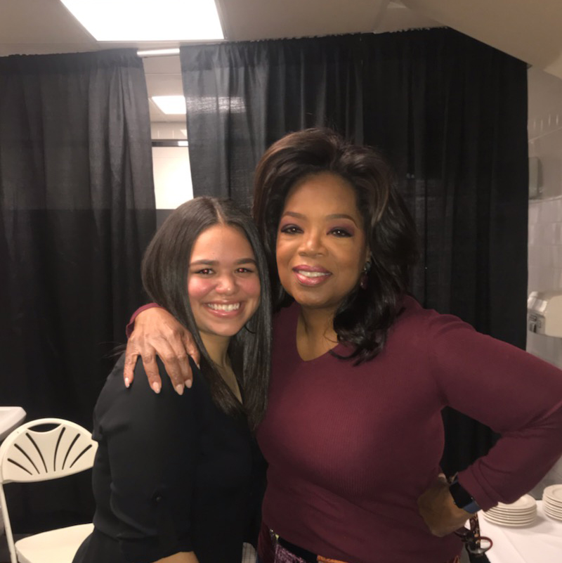 Coral Gonzalez, one of the first UMass Lowell Oprah Winfrey Scholars, poses with Oprah herself