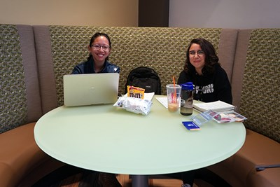 Students study in a corner booth