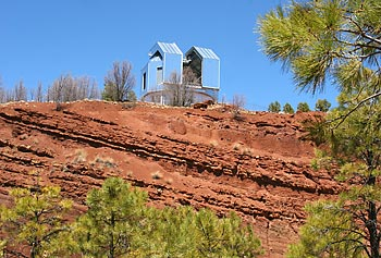 Engineers and technicians are putting the finishing touches on Lowell Observatory's new Discovery Channel Telescope, which sits on top of an ancient cinder cone in Happy Jack, Ariz., at an elevation of 7,760 feet above sea level.