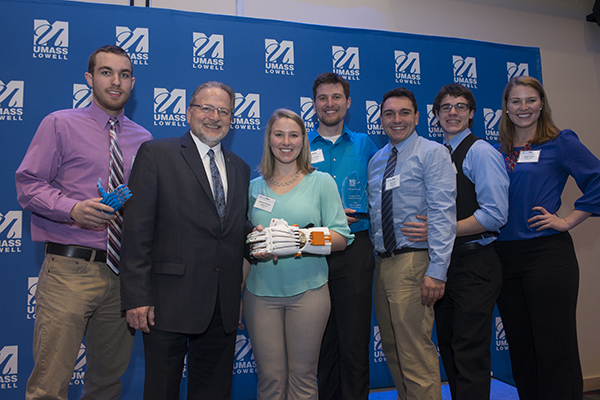 Assoc. Vice Chancellor for Entrepreneurship & Economic Development Steve Tello, second from left, poses with the eNABLE Lowell team after its campuswide DifferenceMaker Idea Challenge win.