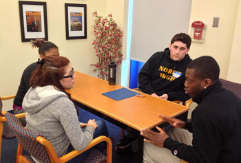 From left, students Bridget Sullivan, Shanice Smith, Justin Towner and Jeff Danso participate in a Diversity Peer Educators training session.