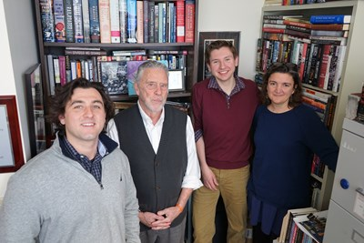 A good chunk of the labor behind the Library of New England Immigration includes (from left) alum Ernest Guerrera '18, History Professor Robert Forrant, junior Cameron Blanchard and Ingrid Hess of the Art & Design department.