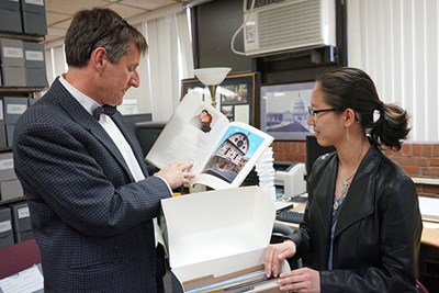 UML History Dept. Chairman Christopher Carlsmith works with Honors College student Amariah Condon on a history of Save Venice Inc.