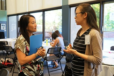 UMass Lowell Assoc. Prof. of Education Phitsamay Uy talks with Lilia Cai-Hurteau, a member of the 2018 cohort for the Ed.D. Leadership in Schooling online degree