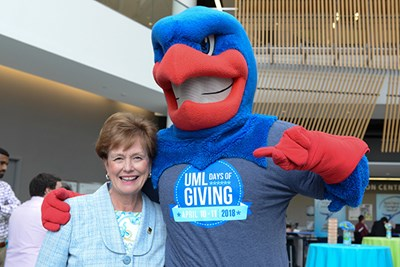 UMass Lowell Chancellor Jacquie Moloney with Rowdy River Hawk at 2018 Days of Giving