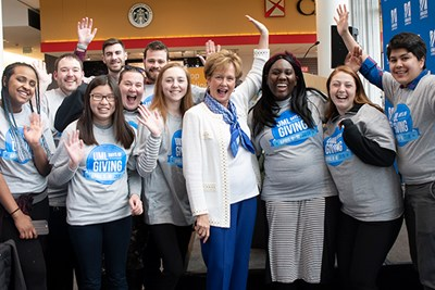 Chancellor Jacquie Moloney celebrates with students