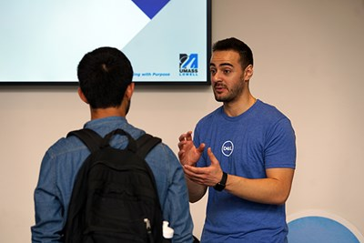 Engineering alum Nabil Saleh talks to a student about Dell