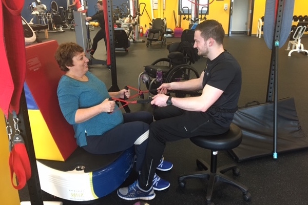 Exercise physiology graduate Derrick Albrecht '15, who works at Project Walk as a recovery specialist, designs customized exercise programs for each client depending upon their individual goals.