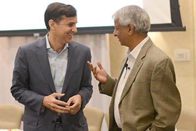 Desh Deshpande, left with Ronald Daniels, right