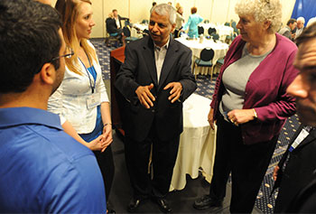 "In June, UMass Lowell will host the third annual Deshpande Symposium on Innovation and Entrepreneurship in Higher Education. Here, Gururaj ""Desh"" Deshpande talks with attendees from last year's conference."