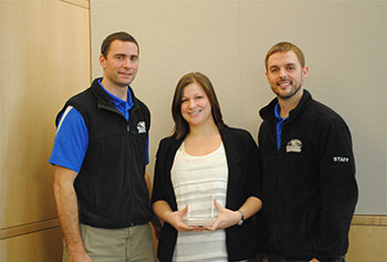 Diana Davis, facility supervisor at the Campus Recreation Center, was named Student Employee of the Year. She is flanked by her supervisors, Campus Rec Director Peter Murray, left, and Associate Director Justin Lawler, right.