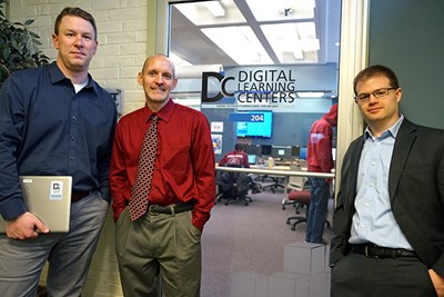 Information Technology staff members stand outside a Digital Learning Center